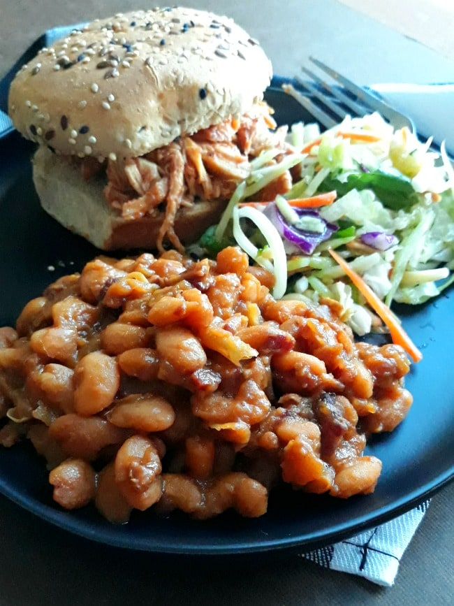 Plate with Pulled BBQ Chicken Sandwich, Coleslaw,  and Amish Baked Beans